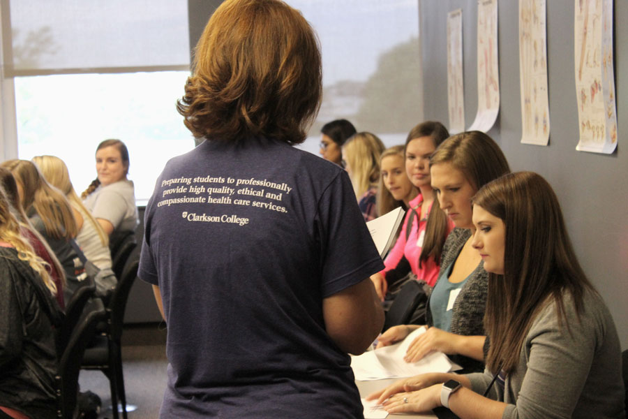 Students listening in a classroom at a New Student Orientation event